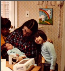 Newborn Mariel with her siblings